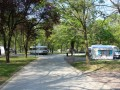 Description of caravan and trailer site: Our Camping offers 92 sites for caravans or trailers. The driveway of the sites is covered in gravel, while their lodging part is covered...